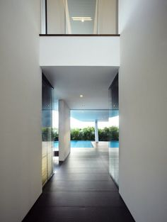 Ninety 7 Siglap Private house in Singapore by Aamer Architects, beautiful hallway to the pool _