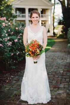 Fall wedding bouquet idea - orange + burgundy bouquet with calla lilies, berries, greenery, dahlias and lilies {Katy Weaver Photography}