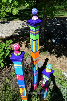 This listing is for the LARGE Garden Totem. The Medium and Small Totems are available in other listings. Or you can purchase all three sizes at once and get them for a discounted price. The Large Totem measures 65 inches from its base to the top of the ball. My garden totems are hand painted on 4 x 4 Western Cedar. Each one is different, each one is unique. They add a great splash of color to your garden either as an accent or the centerpiece. They are protected with a UV protecting marine…