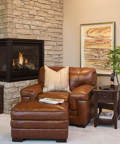 Cozy Nook By The Stacked Stone Fireplace With An Overscaled Leather Chair  And Ottoman. Great