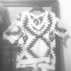 The very best sweater ever  Spense knits is the brand. Size med. it's a short sweater that you would wear a shirt under with or without a collar. The front is a little higher than the back of the sweater. It's cream colored with black Aztec looking print. Let me know if you have any questions. I never wore this. Spense Sweaters V-Necks