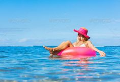 Woman floating on raft in tropical ocean ...  activity, beach, beautiful, beauty, bikini, blue, body, cheerful, colourful, enjoyment, fashion, female, fun, girls, glamour, happiness, happy, hat, healthy, inflatable, joy, laughing, leisure, lie, lifestyle, luxury, mattress, nature, ocean, outdoor, people, person, raft, relax, relaxation, sea, sexy, summer, summertime, sun, sunshine, suntan, swim, swimsuit, swimwear, vacation, water, white, woman, young