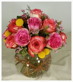 Bubble Bowl Centerpiece With Roses, Billie Balls And Wax Flower. LOG CABIN  FLORIST