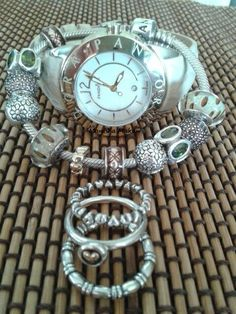 PANDORA Imagine Watch in Cream n Gold. Three Ring Stack.  Bracelet with Leopard Murano, Green Oval Lights, Brown Pave and Brown Enamel Charms and a hint of Gold ♡♥♡  Lovely!