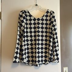 Checked Criss Cross Bell Sleeve Blouse Worn a couple of times. Like new. Cut out in back with criss cross detail. Lila brand, listed as F21 for exposure. Forever 21 Tops Blouses