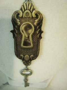 Keyhole Wood Pendant Necklace, with face. $25.50, via Etsy.