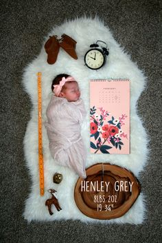 diy unique creative baby girl birth announcement | henley grey baby name. rifle paper co. calendar. Kikkerland yellow ruler. IKEA clock and rug. Gap kids moccasins. Kindred oak blush swaddle. Baby beans and me headband. Target deer ornament. Thrifted brass owl. World market wood charger.