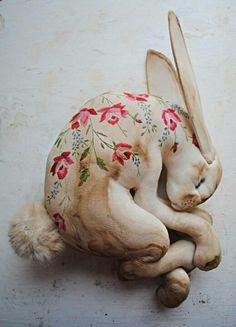 Sleeping hare made from vintage table cloth - Obsessed with this for the corner of a daybed or a wicker love seat on a big screened in porch.