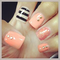 Nail Recipe: Peach Colored  Nails w/  2   Gold Stud Accents towards the cuticles of the thumb middle & pinky fingers   & 1 Rose Gold Sun Glitter Dusted Accented Nail 1 Bone Ivory & Black   Horizontal striped Accented Nail