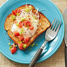 Tomatoes, green onions, and Parmesan cheese add unexpected freshness to this open-face egg sandwich: http://www.bhg.com/recipes/breakfast/brunch/egg-recipe-ideas-for-brunch/?socsrc=bhgpin021414friedeggtoast&page=10