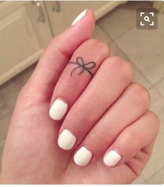 Bow finger tattoo
