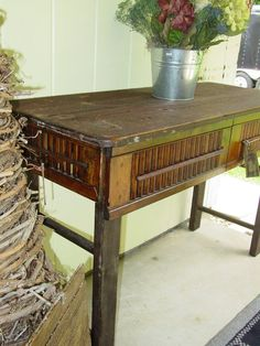 What do you get when you nail together old shutters, sawed off pieces of a wooden ladder, and other scrap wood? An outdoor table, of course. (Cool potting shed table idea)