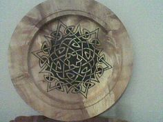 Wooden place with Celtic design pirographed