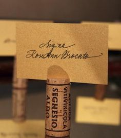 Place card holders made from wine corks.