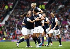 U.S. Soccer team celebrates after Abby Wambach scores against North Korea