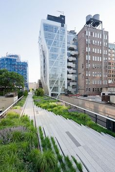 """The High Line is a New York City linear park built on a section of the former elevated New York Central Railroad spur called the West Side Line, which runs along the lower west side of Manhattan; it has been redesigned and planted as an aerial greenway. The angled building to the right is """"HL23,"""" a 14 floor condominium tower designed by Neil M. Denari, Architects."""