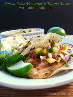 Spiced Lime Vinaigrette Tilapia Tacos with pineapple salsa (must make these this summer!)