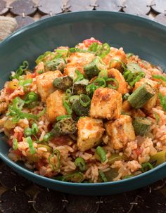 Dirty rice is a hallmark of cooking in the American South. It's made by simmering rice with ingredients like spices and aromatics (typically onion, celery and bell pepper), which deliciously infuse it and alter its color. In our Cajun-inspired version, we're adding tofu and okra.