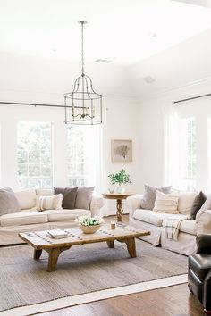 Coastal Farmhouse Living Room - German Smear Stone Fireplace - Layered Rug - Fiddle Leaf Fig - Home Tour - Modern Farmhouse Design - Farmhouse Living - Slipped Covered Couch - Sherwin Williams…More Modern Farmhouse Design, Coastal Farmhouse, Farmhouse Style, Farmhouse Rugs, Country Farmhouse Decor, Farmhouse Lighting, Coastal Cottage, Farmhouse Ideas, Fresh Farmhouse