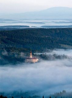 Orlické mountains and castle in Náchod emerging from the fog (East Bohemia), Czechia