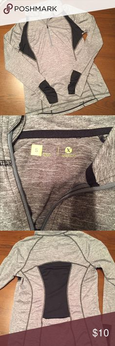 Athletic long sleeve top Athletic long sleeve top with thumb holes and pocket in the back. Barely used. Great condition. Partial zip front. Moisture wick. Xersion Tops Sweatshirts & Hoodies