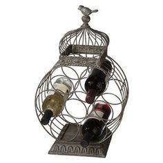 """Showcase your favorite bottles or display the wine pairings for dinner with this beautiful design.    Product: Wine holderConstruction Material: MetalColor: GrayFeatures: Holds seven bottles  Dimensions: 19.75"""" H x 12.5"""" W x 9.25"""" D"""