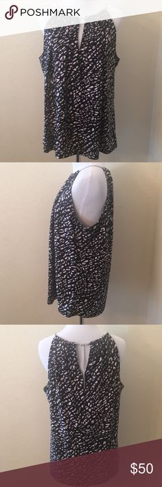 """NWT Michael Kors Black And White Top Size Large NWT Michael Kors Size Large Key hole opening in front and back Silver roping around neck  Closes by a chain on back of neck  Pit to Pit measures 22"""" Back Chain to hem measures 24"""" Michael Kors Collection Tops Blouses"""