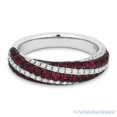 The featured ring is cast in 18k white gold and showcases alternating rows of round cut diamonds & round cut rubies encrusted on black gold pave settings.