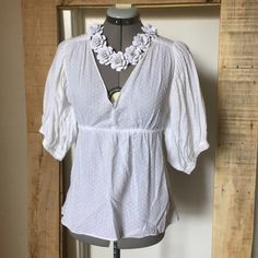 """BOGO 1/2 Off Sale! Marty M White Boho Peasant Top BOGO 1/2 Off Sale! Marty M White Blouson Peasant Top. Size S measures: 13.5"""" across shoulders, up to 17"""" across at elastic high waist, 24"""" long. 100% cotton. Missing the belt. 305/027/040216 **Lesser item will be half. See details in sale listing. Valid only in my closet on items $10 or more. Matty M Tops Blouses"""