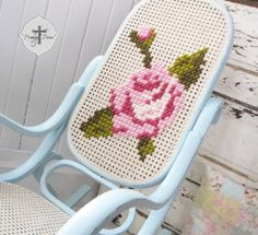 So original! A bentwood rocker prettied up with needlepoint.