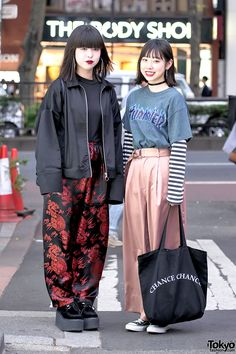 Nanase and Luna - both 17-year-old high school students - on the street in Harajuku. They are wearing satin pants (pajama style pants super trendy in Harajuku now) from the vintage shop Faith Tokyo along with hoop earrings, bags from MYOB NYC and ChanceChance, Nadia platforms, Converse, and Thrasher.