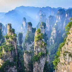 Zhangjiajie, Hunan Province, China. The tall, skinny mountains in Avatar? Yep, that's in China. You won't find peculiar blue and purple animals in Zhangjiajie, though.