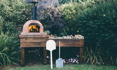 An outdoor kitchen can be an addition to your home and backyard that can completely change your style of living and entertaining. Earlier, barbecues temporarily set up, formed the extent of culinary attempts, but now cooking outdoors has become an. Backyard Kitchen, Outdoor Kitchen Design, Backyard Patio, Outdoor Kitchens, Patio Design, Outdoor Rooms, Outdoor Living, Diy Pizza Oven, Pizza Oven Outdoor
