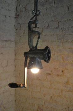 To Transform Simple Kitchen Utensils Into Light Fixtures How about a pendant light made from a meat grinder?How about a pendant light made from a meat grinder? Rustic Lamps, Rustic Lighting, Industrial Lighting, Kitchen Lighting, Industrial Style, Lighting Design, Lighting Ideas, Industrial Windows, Task Lighting