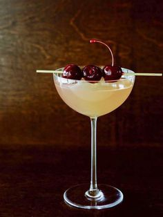 The classic St-Germain cocktail gets kicked up a notch with ginger and a colorful cherry garnish. #elderflower ginger fizz #yum!