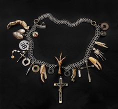 Lost Soul, Found Spirit 1996 Robert Ebendorf, born Topeka, KS 1938 mixed media: paint on metal, pearls, squirrel's foot, glass, crab claws, metal and wood crucifixes, metal fountain pen tip, chicken's foot, metal, ink on paper under plexi in metal, on a metal chain