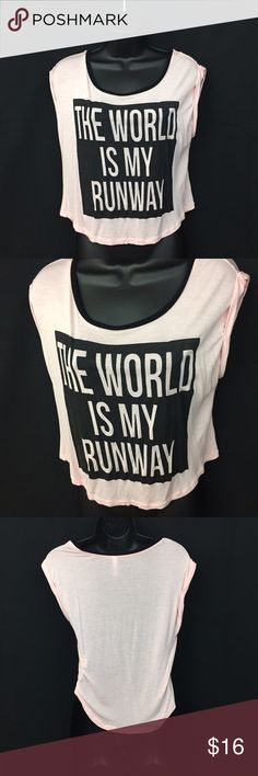 "🎉 Ladies graphic top - "" the world is my runway "" Ladies graphic top - "" the world is my runway "". Color: Pink & black. New without tags . Size M Tops"