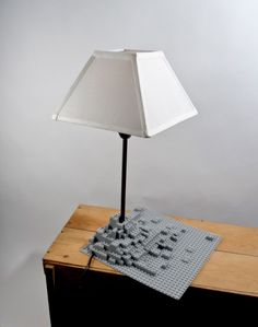 The idea for the lego lamp was to serve as a metaphor for a lunar landscape. Uniform legos where assembled to form the base for the lamp and coated in several layers of spray urethane paint. - See more at: http://leketoys.no/portfolios/fun-light