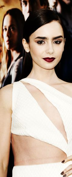 Lily Collins ♥ this look: Dark, vampy lips and lashes for days.