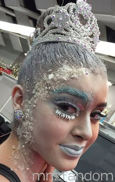 [S5E4] Kalani Hilliker in the dressing room in full hair and makeup.