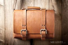 You know what makes a leather bag durable – that it's built from the finest Full-Grain Vegetable-Tanned leather in the U.S. It's a bag riveted together with solid brass rivets that wont wear out over time. There's no stitching to break. I designed this leather bag to last a lifetime and put up with the heavy use that you'll give it. This bag, or leather briefcase is big enough to fit your books, laptop, notes and all your carry goods. It has one large central storage area as well as a back…