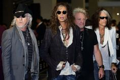 You can't honor social media's biggest pop stars without inviting cool rock stars to the party. Aerosmith arrive at the Social Star Awards on May 23 in Singapore