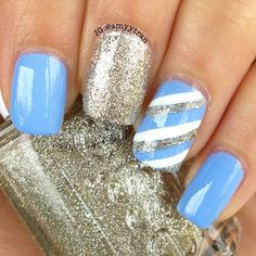 A combination of blue nails, a glitter nail, and a blue, silver, and white striped nail