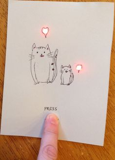 """My goal for several months has been to make an electronic greeting card that is like the ones you can buy--""""Press Here"""" for the action (in this case, just simple LEDs), no visible battery or circui..."""