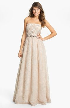 Free shipping and returns on Adrianna Papell Strapless Soutache Gown at Nordstrom.com. Soft soutache flowers that cover a strapless ballgown are interspersed with swirls over the bodice. The narrow banded waist is encrusted with beads and crystals at the front.