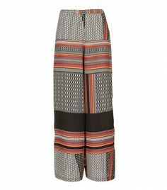 @Who What Wear - Topshop Tribal Border Wide Leg Trousers ($90)  A clean, white crop top and straw hat will look superb alongside these tribal print pants.