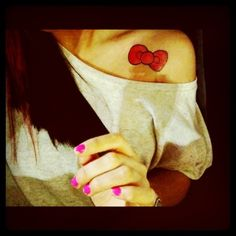 hello kitty bow tattoo..i like the placement too