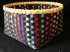 Large Hand Woven Basket in many colors covered with Black. I hand dye basket reed in a very intense dye bath to get bright, vivid colors and