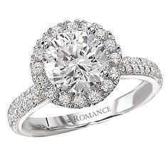 """""""Amy"""" exclusive Halo Diamond engagement ring."""