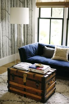Navy Sofa, Vintage Trunk As Coffee Table